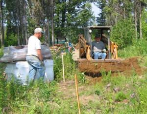 Digging pit with front loader