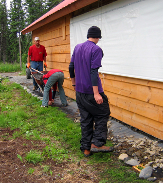 Filling gravel along the kitchen