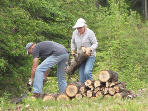 Doris & Richard stacking wood