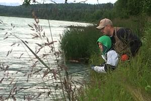 Kam fishing on the Kenai with his Dad